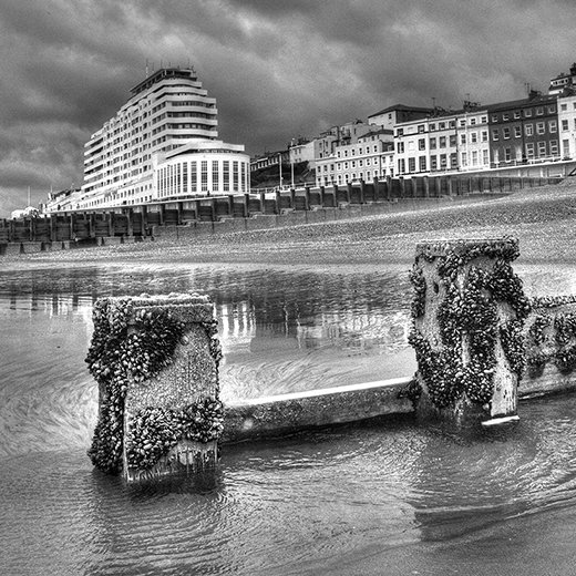 Photograph of Marine Court St. Leonards-on-Sea at low tide by Jon Wilhelm